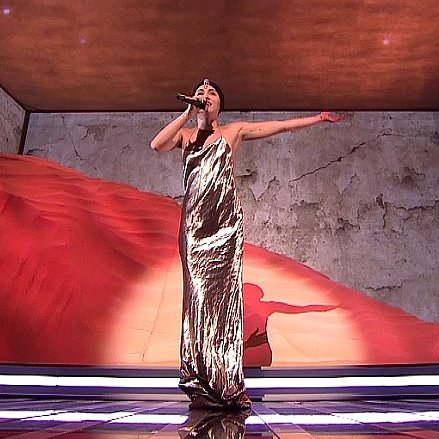 Miley Cyrus in Gold Dress at The X Factor