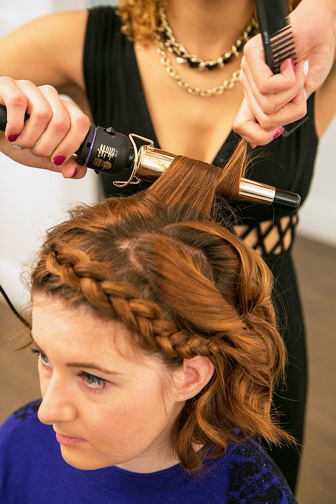 Let down the top section of hair to conceal the end of your braid, and add in more waves with your curling iron. Source: Caroline Voagen Nelson