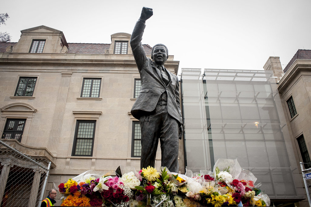 Outside the South African Embassy in Washington DC, flowers were placed beside the Mandela statue.