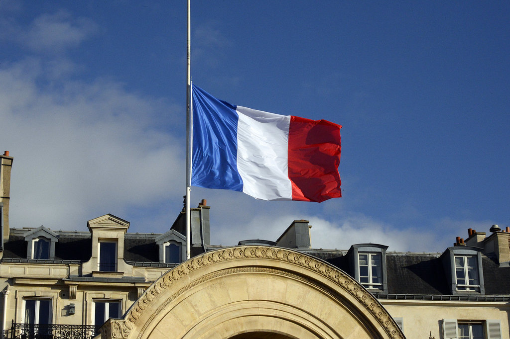 The flag outside the presidential palace in Paris flew at half mast.