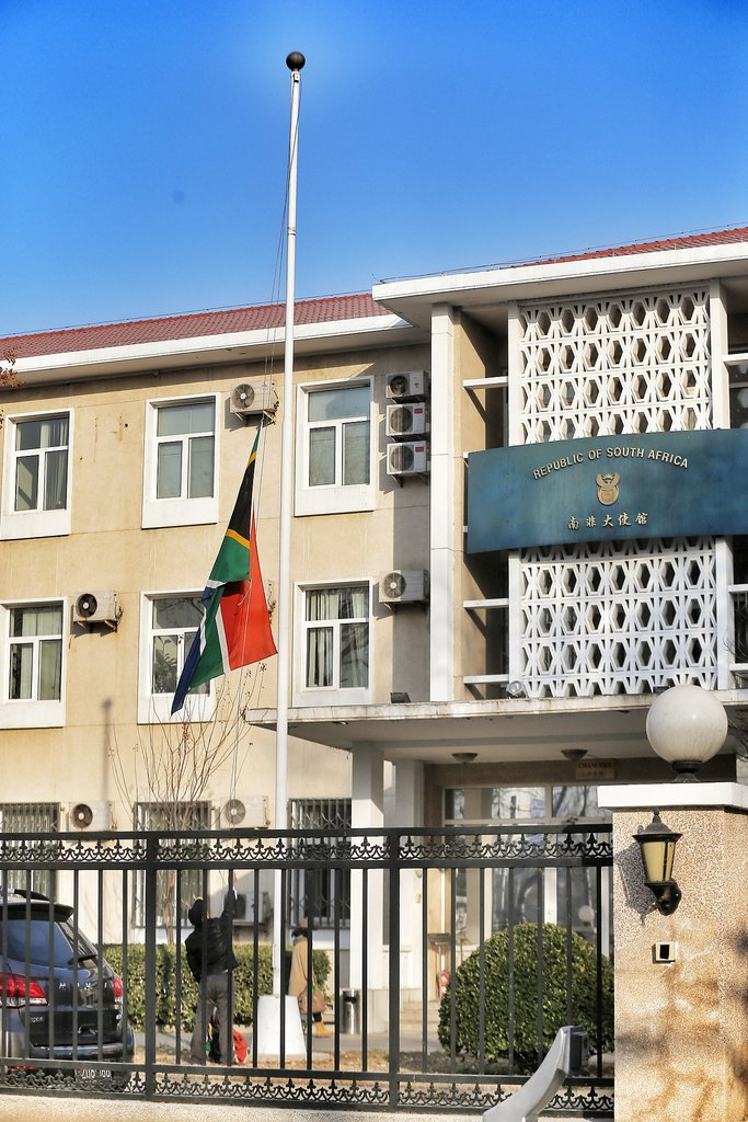 The South African flag flew at half mast at the embassy in Beijing, China.