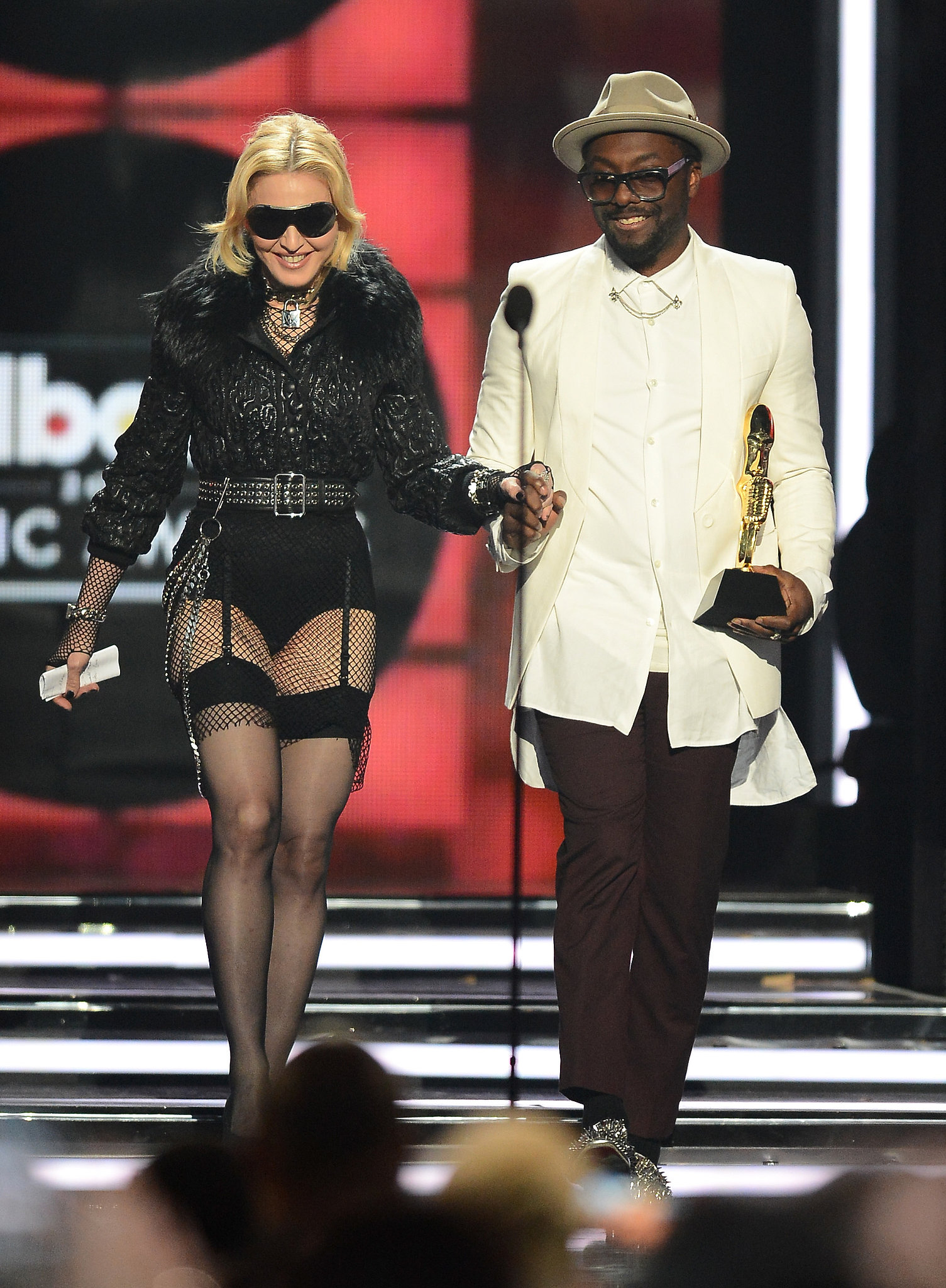 A pantsless Madonna took the stage at the Billboard Music Awards, accepting the award for touring artist of the year from Will.i.am.