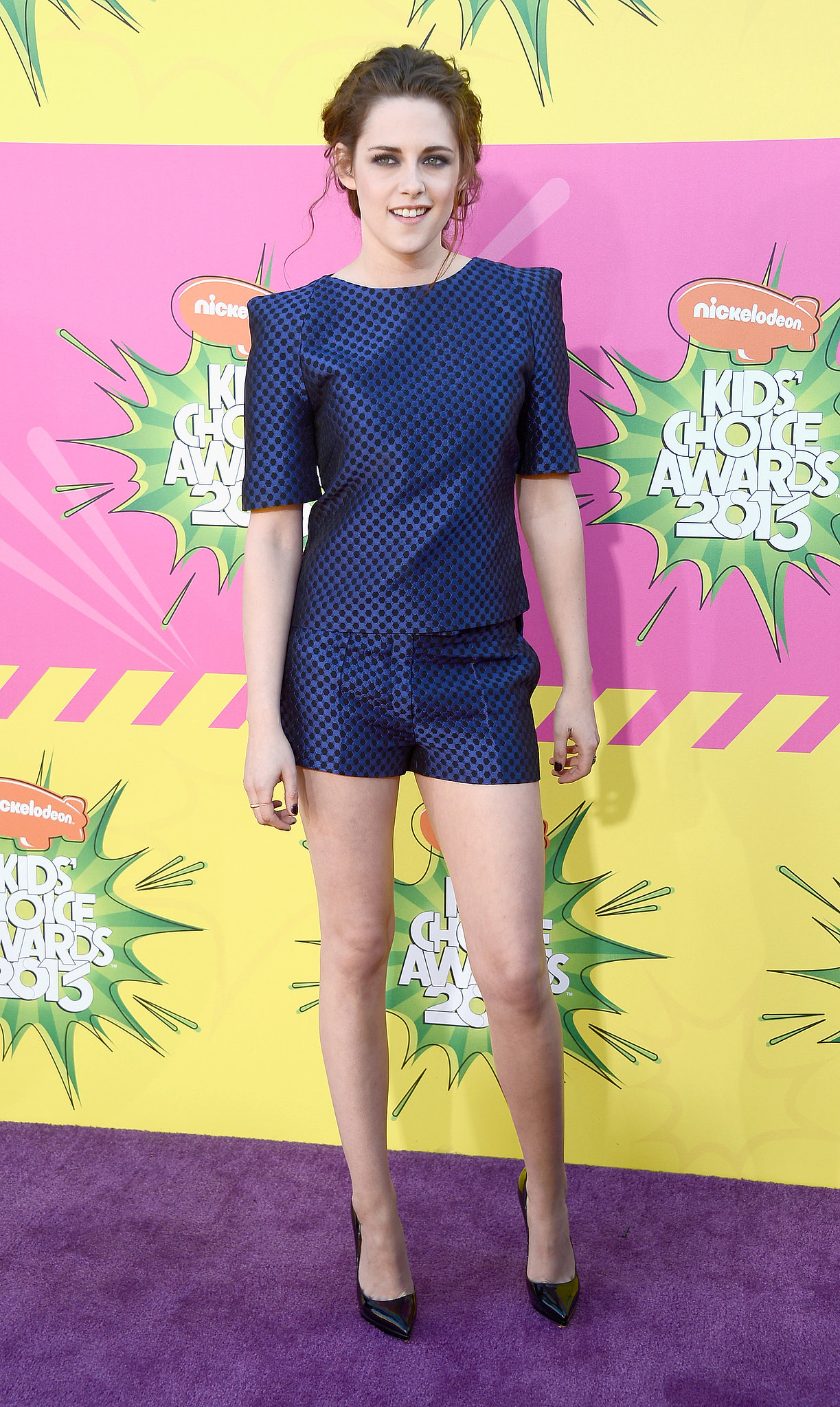 Kristen Stewart was all smiles at the Kids Choice Awards, showing some leg in short Osman shorts.