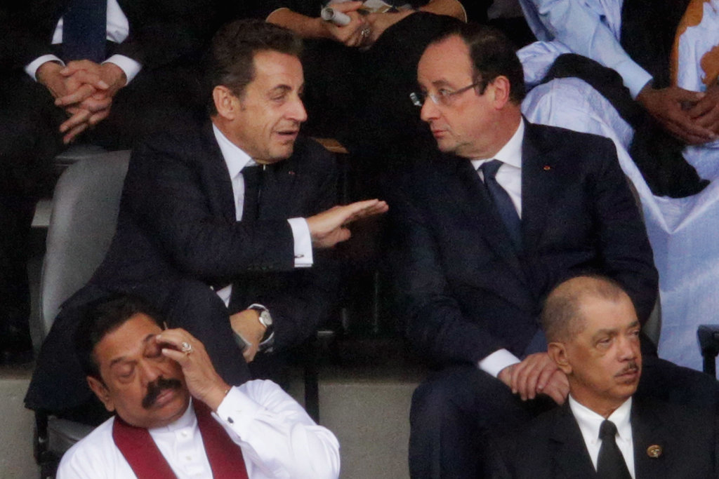 Former French President Nicolas Sarkozy and current French President Francois Hollande were among the world leaders gathered at the memorial.