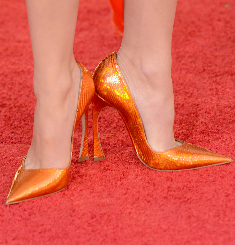 For the Golden Globes, Marion Cotillard picked bright orange heels.