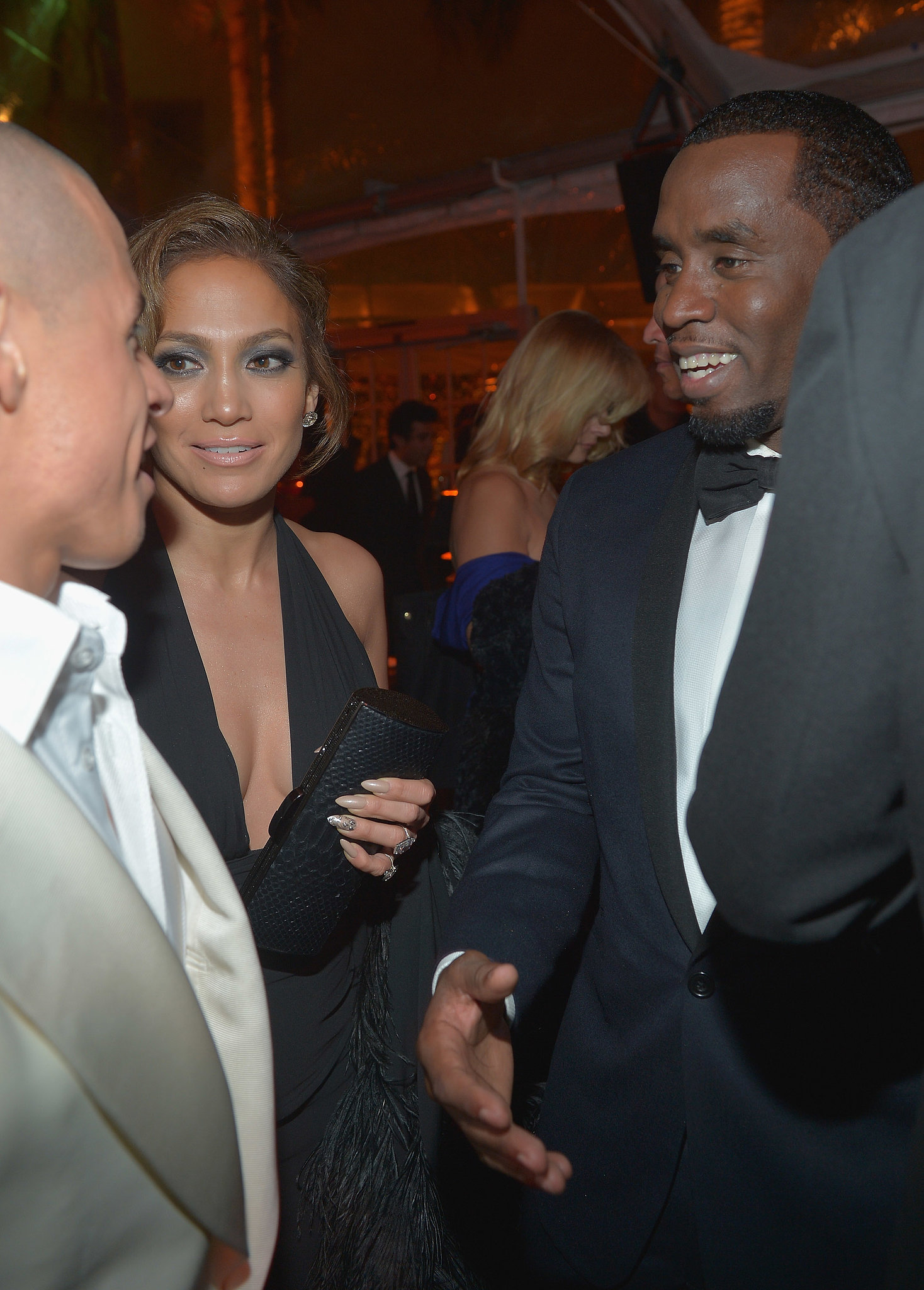Jennifer Lopez introduced ex-boyfriend Diddy to her current beau, Casper Smart, at a Golden Globes afterparty.