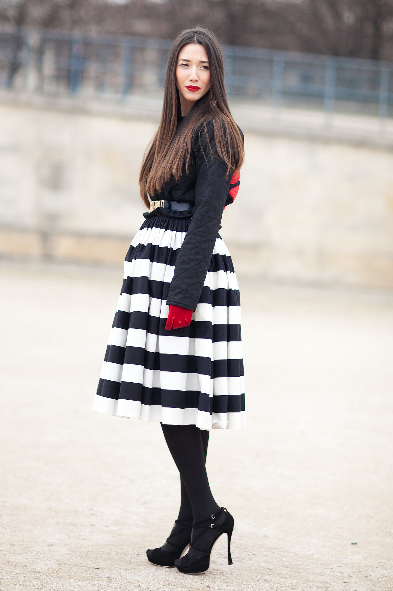 With black, white, and a few bright spots of red, this outfit was all about color palette dedication.