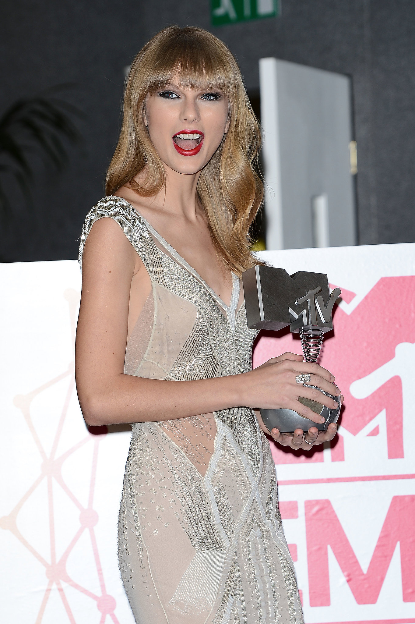 She posed backstage with her MTV EMA trophy in November 2012.