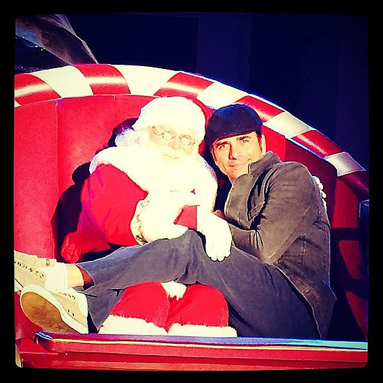 "John Stamos cozied up to Santa in a fun Instagram photo, writing, ""This guy sleighs me.""  Source: Instagram user johnstamos"