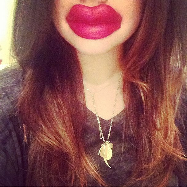 Lucy Hale Puckered up With a