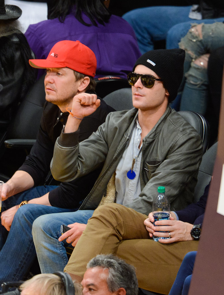 Zac Efron kept his sunglasses on during the game.