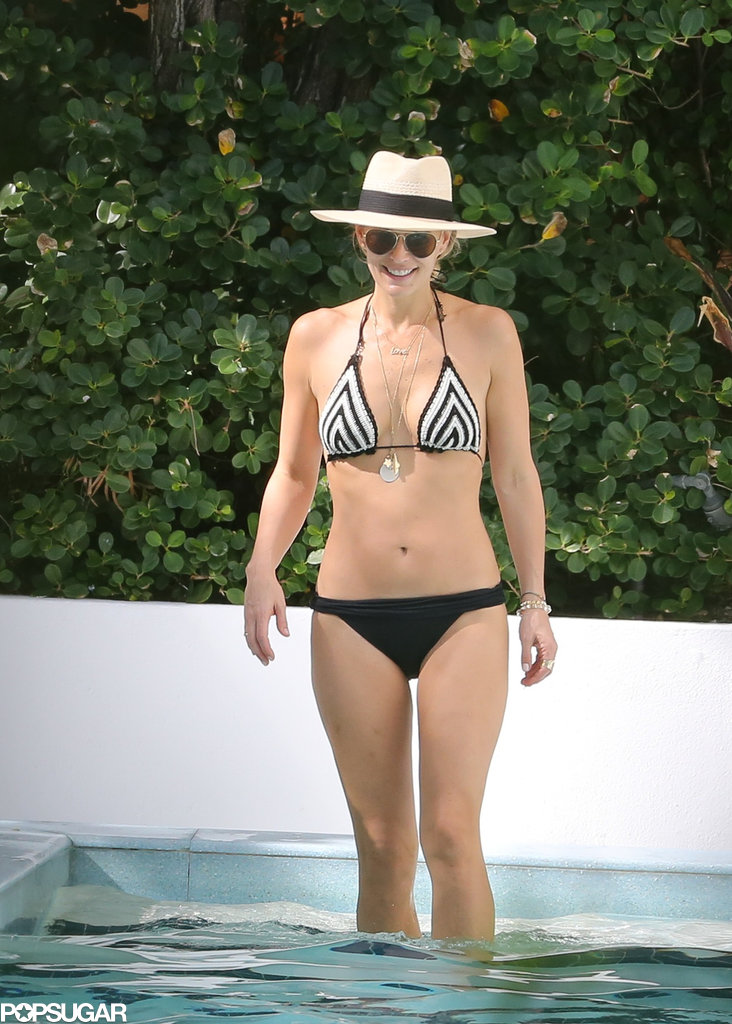 Molly Sims flaunted her figure in a bikini in Miami Beach, FL.