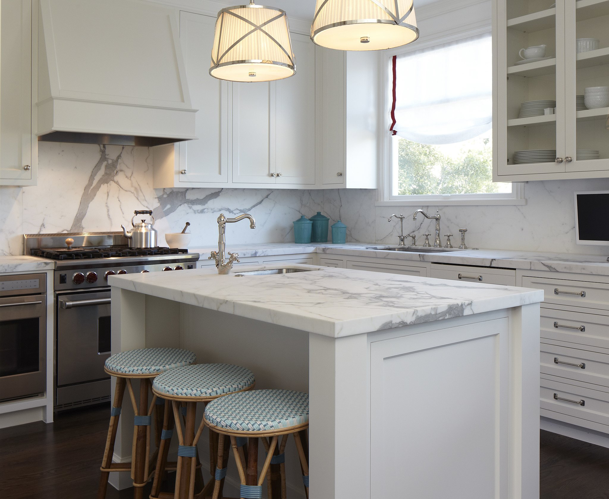 A Honed Marble Island Provides Additional Work Surface And