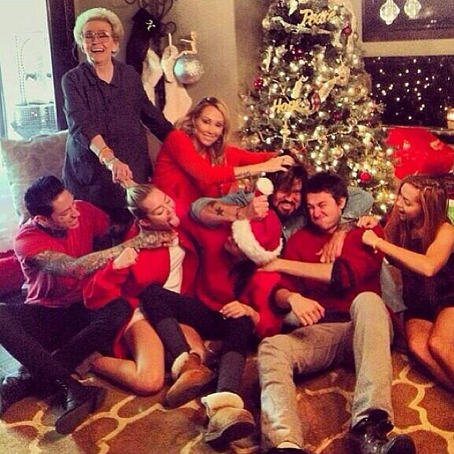 "Miley Cyrus and family engaged in their ""annual family fistfight."" Source: Instagram user mileycyrus"