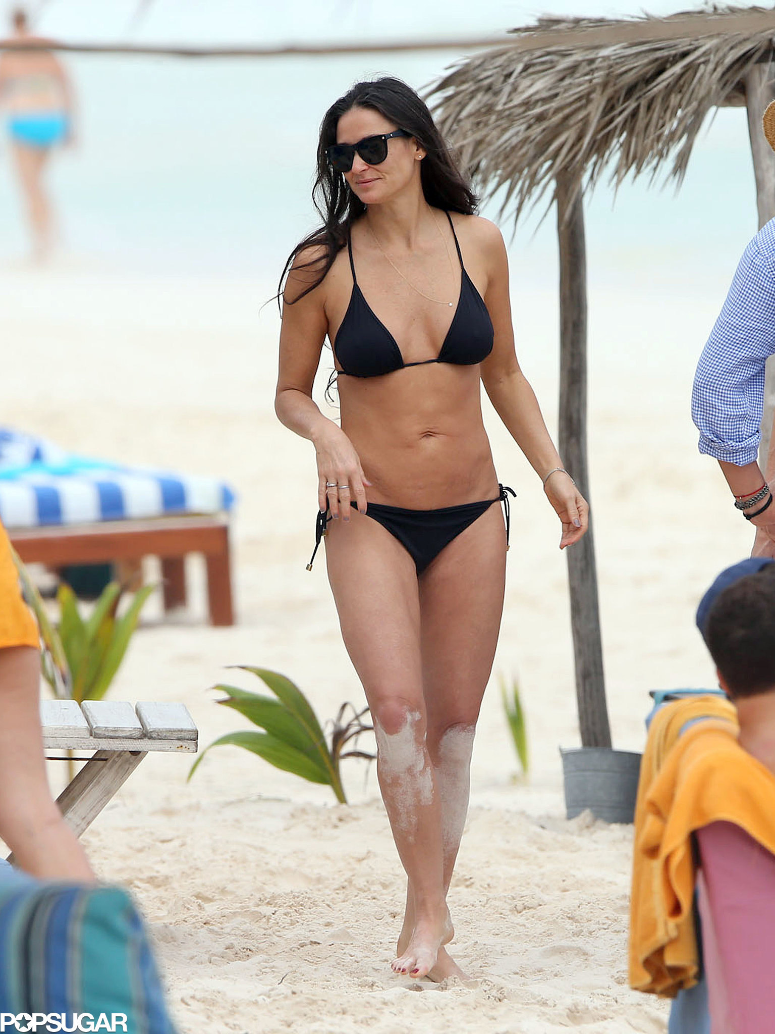 Demi Moore flaunted her fit figure while spending the holidays in Cancun with her daughters and new boyfriend this week.