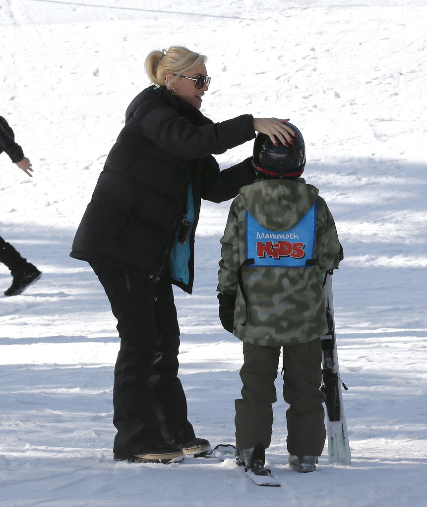 Gwen adjusted Kingston's ski gear.