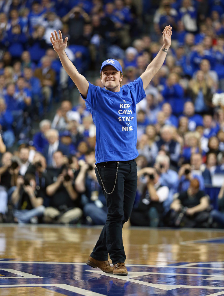 Josh Hutcherson waved to the crowd during a Kentucky Wildcats game on Saturday and was given the signature Mockingjay salute — a solemn, silent three fingers in the air — by thousands of fans.