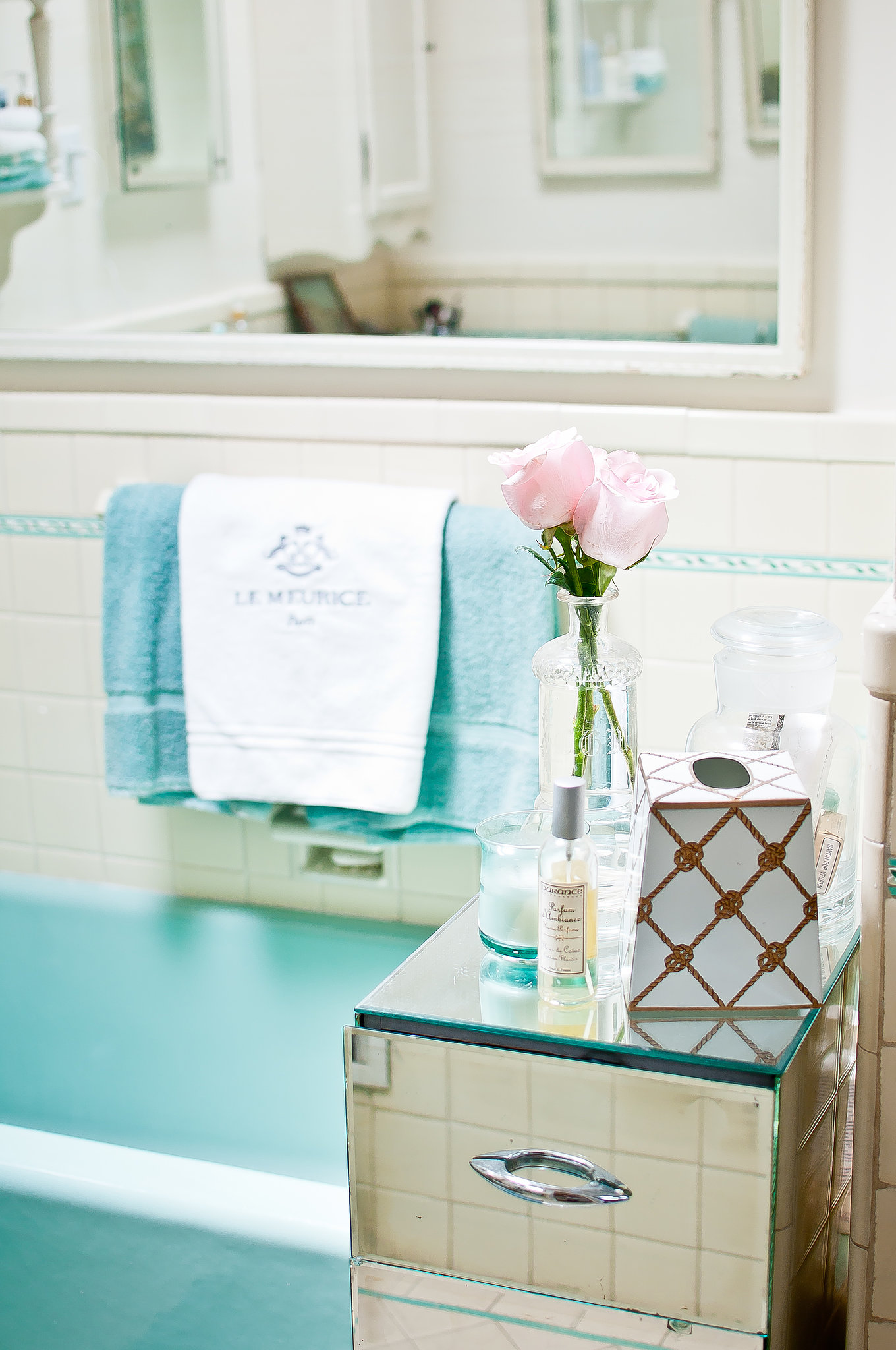 A pale blue retro tub is masterfully integrated with the bedroom's color palette. Source: Kassie Borreson