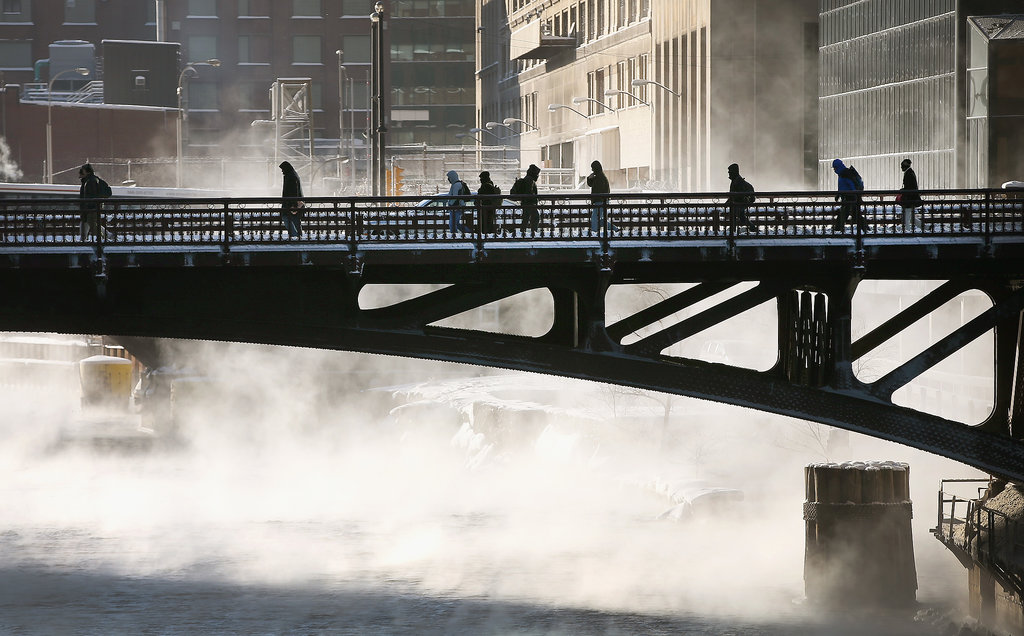 Commuters braved subzero temperatures as they crossed the Chicago River.