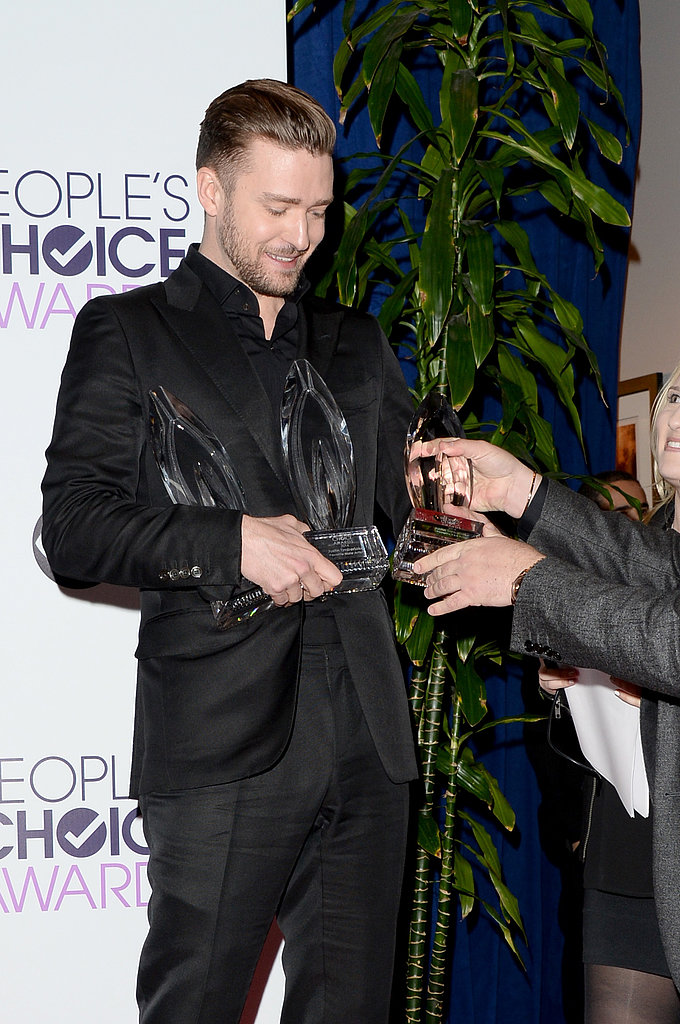 Justin Timberlake needed help with his awards in the press room.