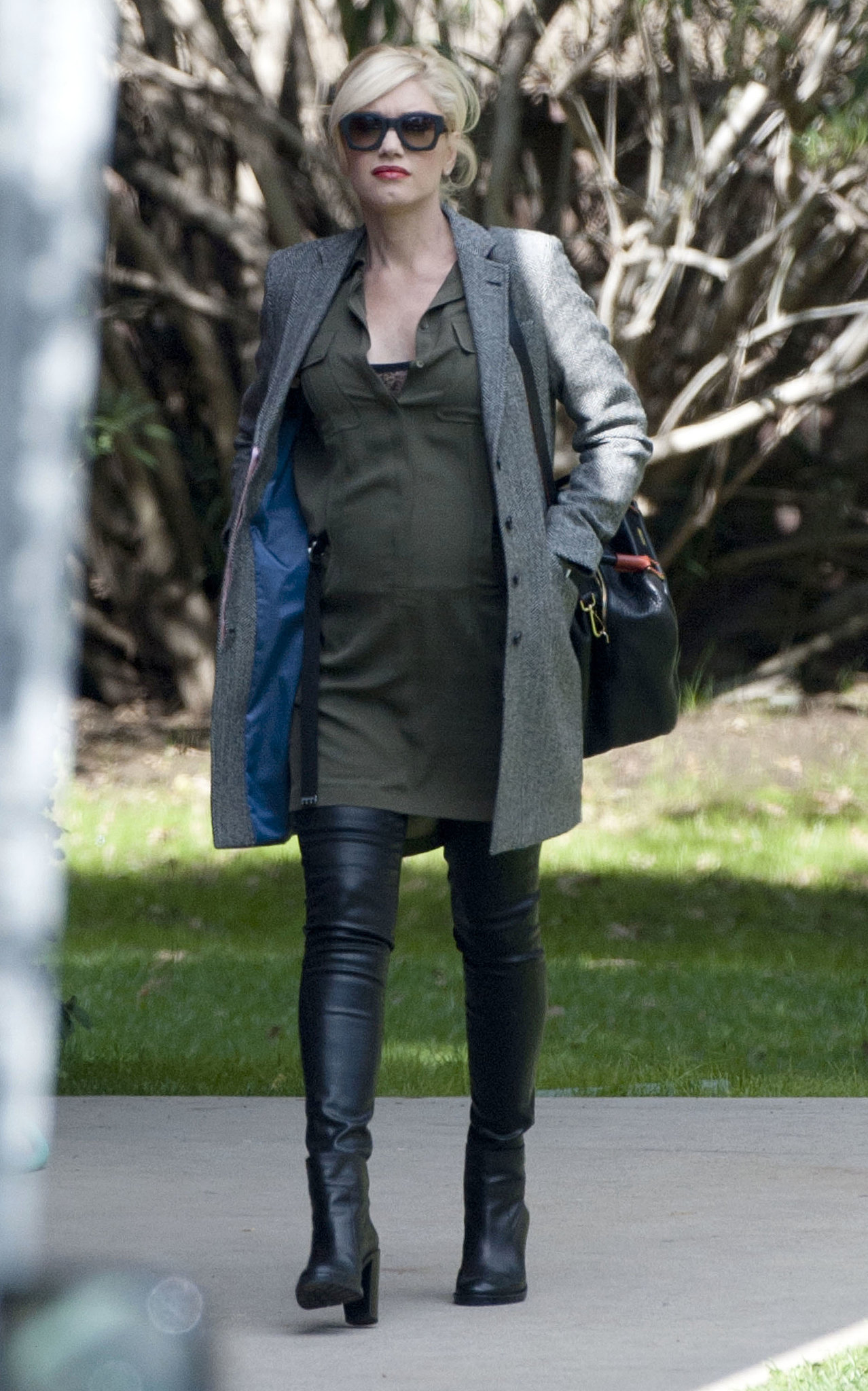 Business casual for Gwen meant a silky dress, over-the-knee boots, and a long tailored blazer.