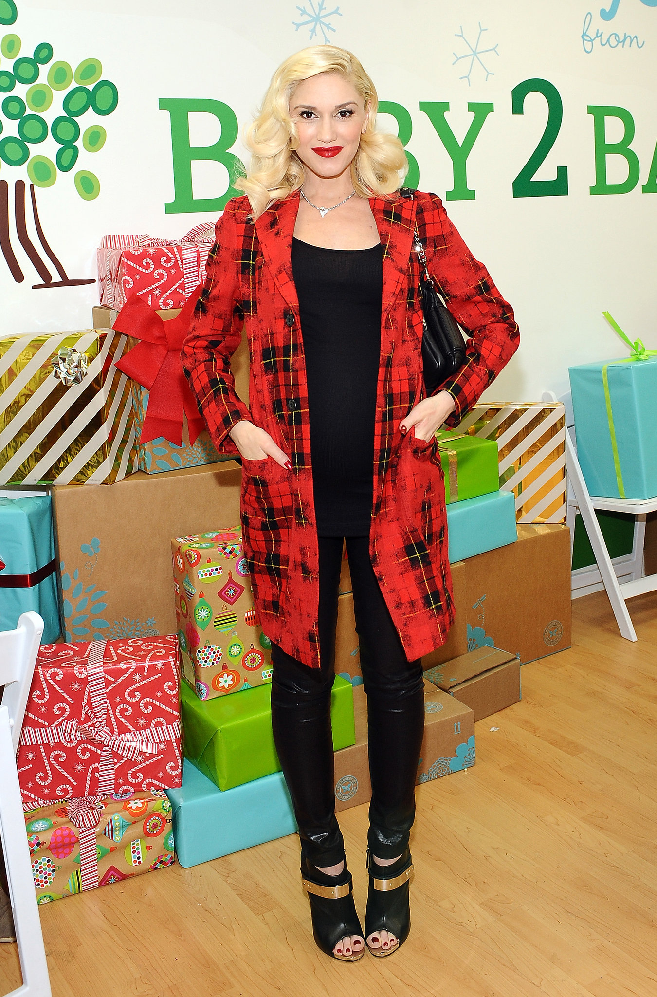 When you're Gwen, a simple trench will never do. Instead, she used her red plaid coat to get into the spirit during a holiday party out in LA.