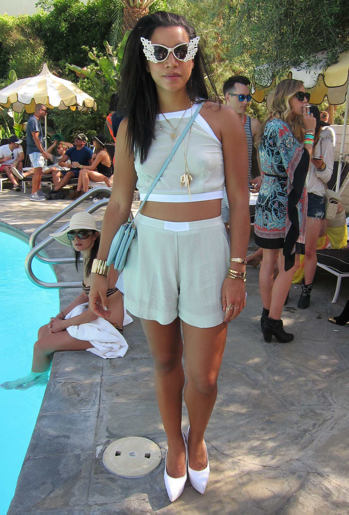 Bold accessories were tempered with a light mint green crop top and high-waisted shorts for a striking party ensemble. Source: Chi Diem Chau