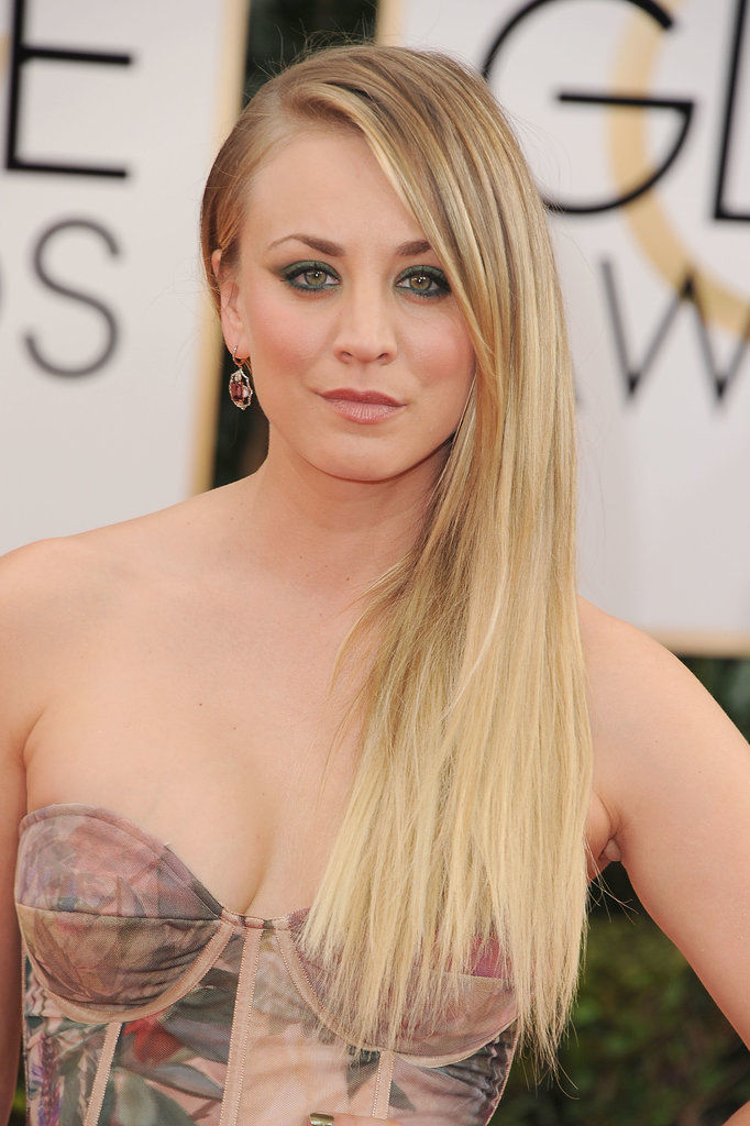 An undercut 'do and emerald eye shadow for Ms. Kaley Cuoco.