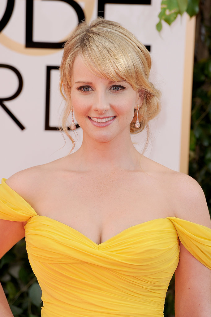 A petal-pink lipstick and face-framing tendrils for Melissa Rauch.