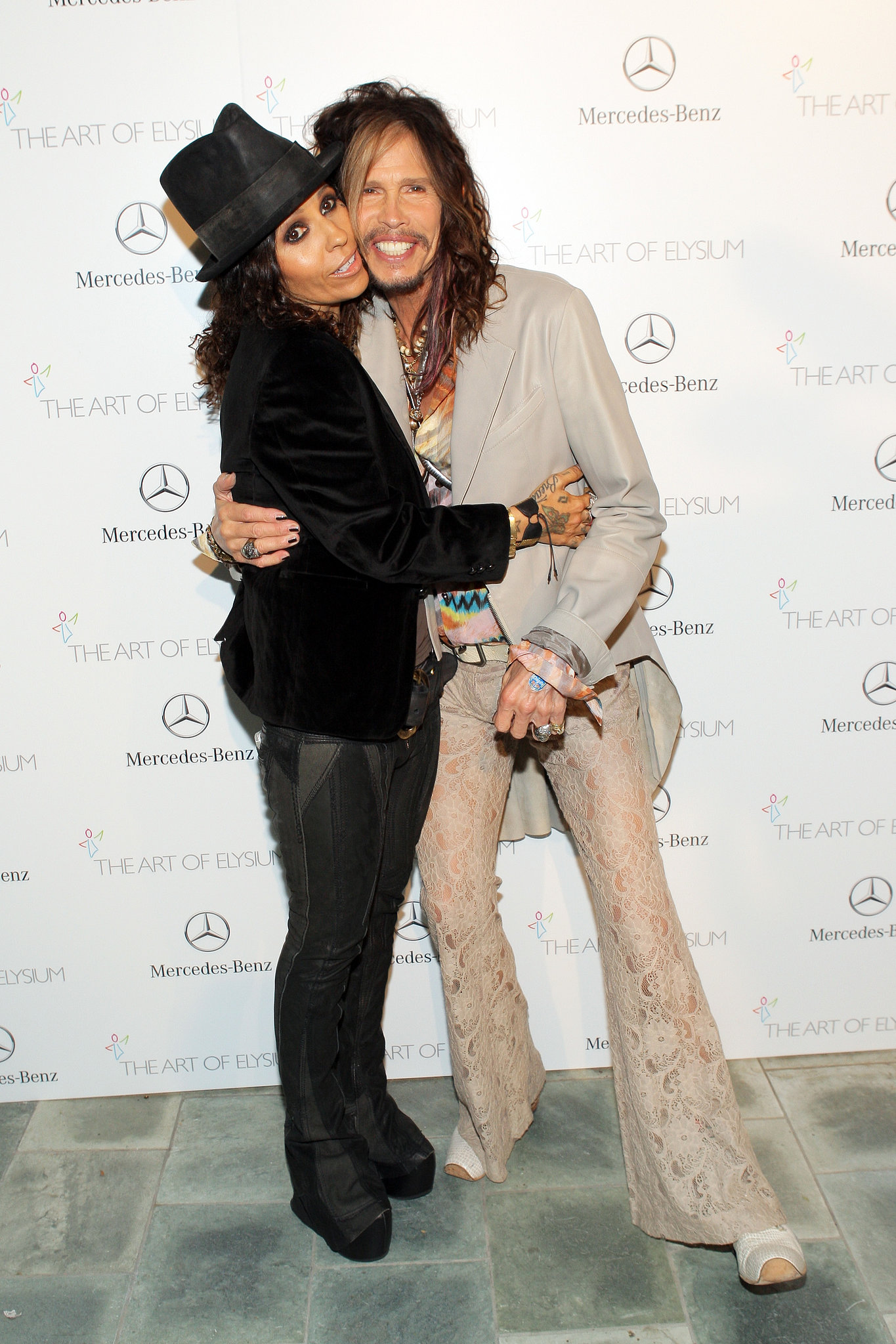 Linda Perry and Steven Tyler had fun when they both arrived at the party.