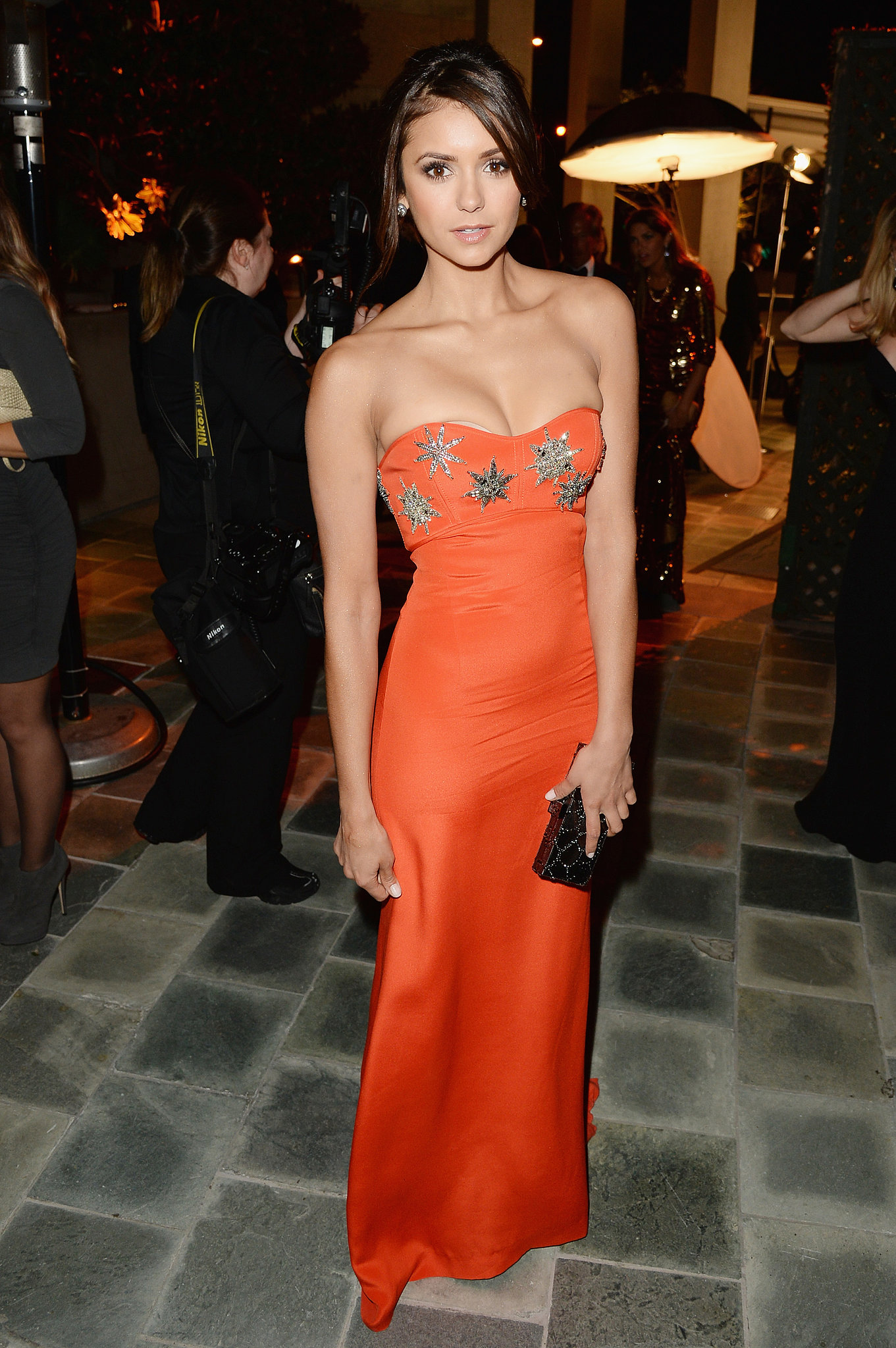On Saturday, Nina Dobrev wore an orange Pucci gown to the Art of Elysium event.
