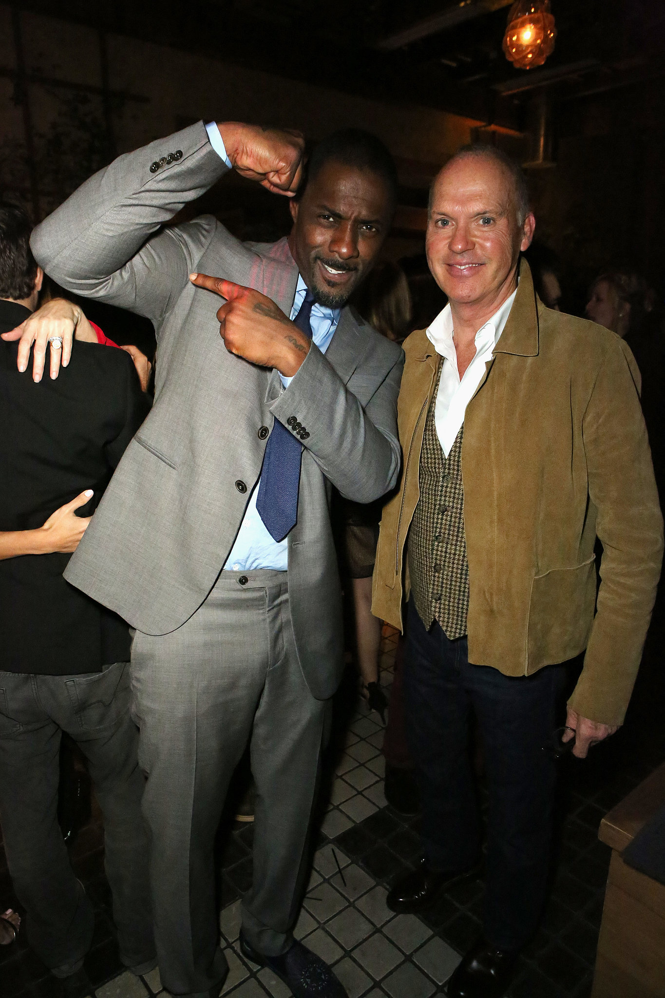 Idris Elba showed off his muscles with Michael Keaton.