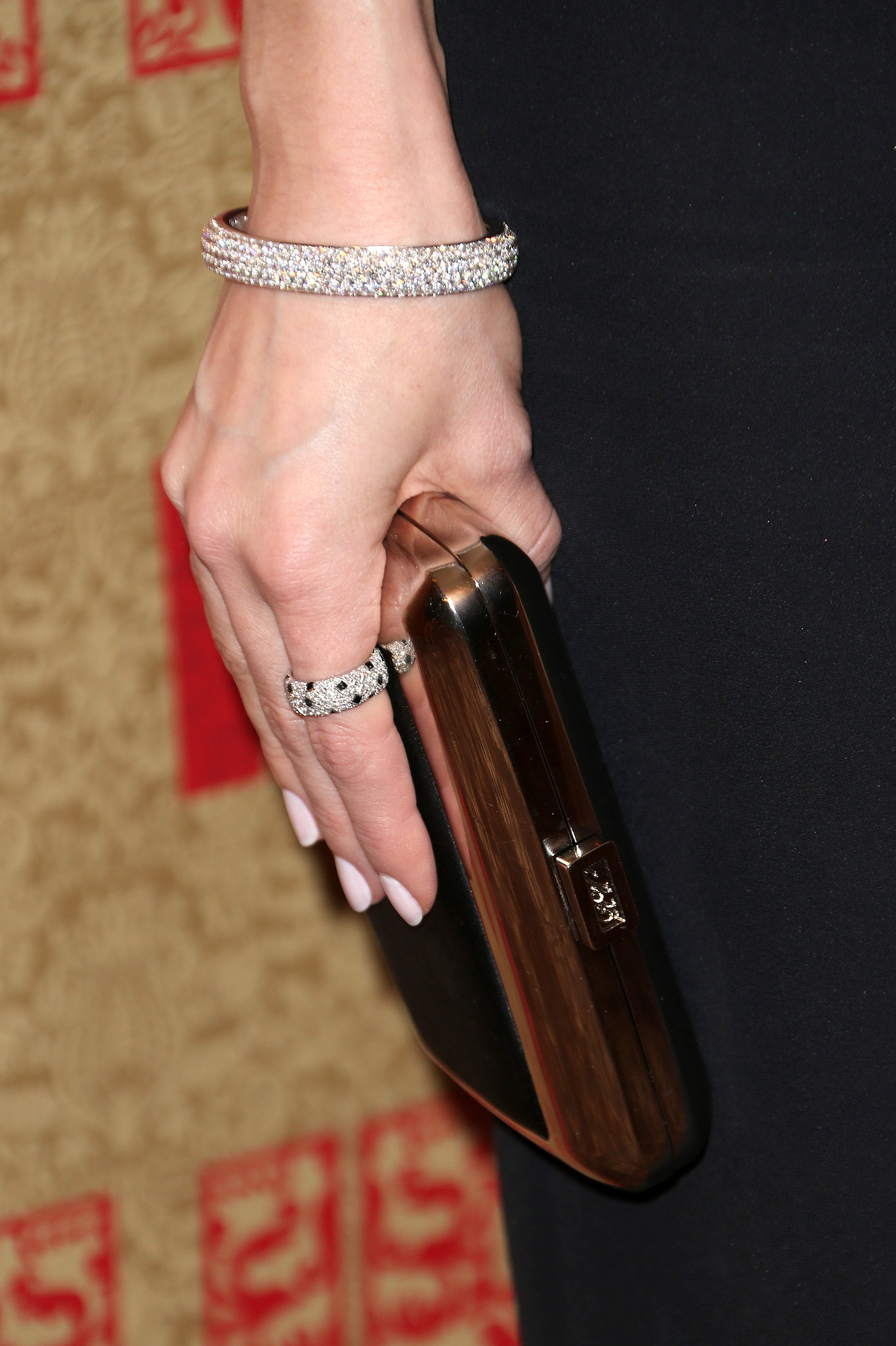 Just look at all those diamonds — Allison Williams added a Cartier pavé bracelet and ring to her ensemble, then finis