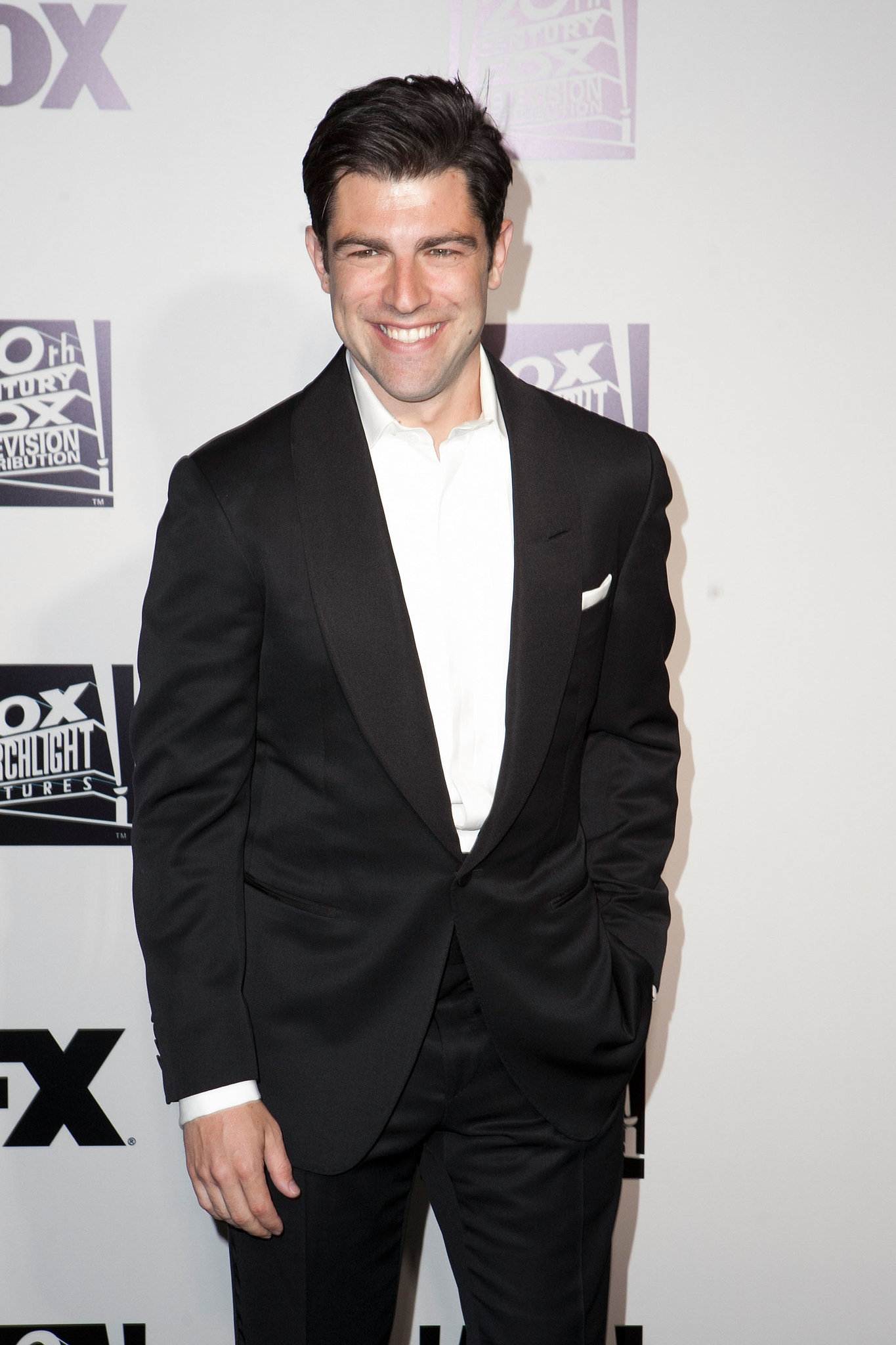 Max Greenfield grinned.