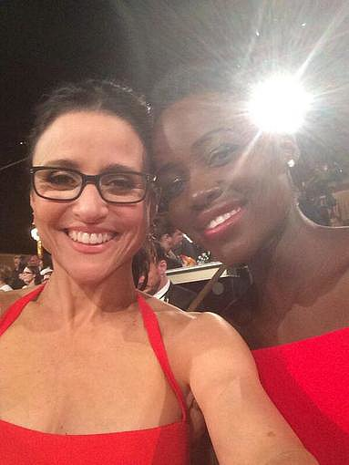"Julia Louis-Dreyfus snapped a selfie with Lupita Nyong'o, adding the caption ""2 losers."" Source: Twitter user OfficialJLD"