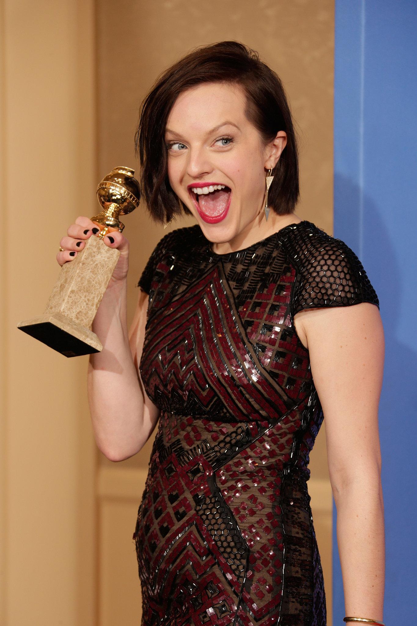Elisabeth Moss showed her shocked face as she celebrated her Globe win backstage.