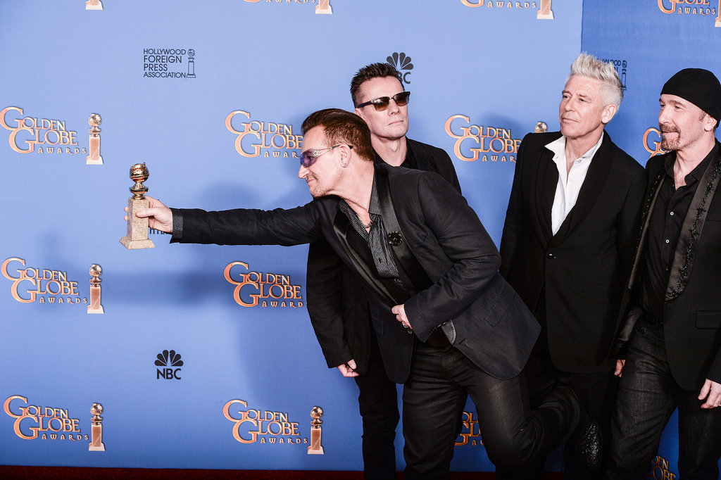 """Bono held out his Golden Globe for all to see after U2 won the best original song award for """"Ordinary Love"""" from Mandela: Long Walk to Freedom."""