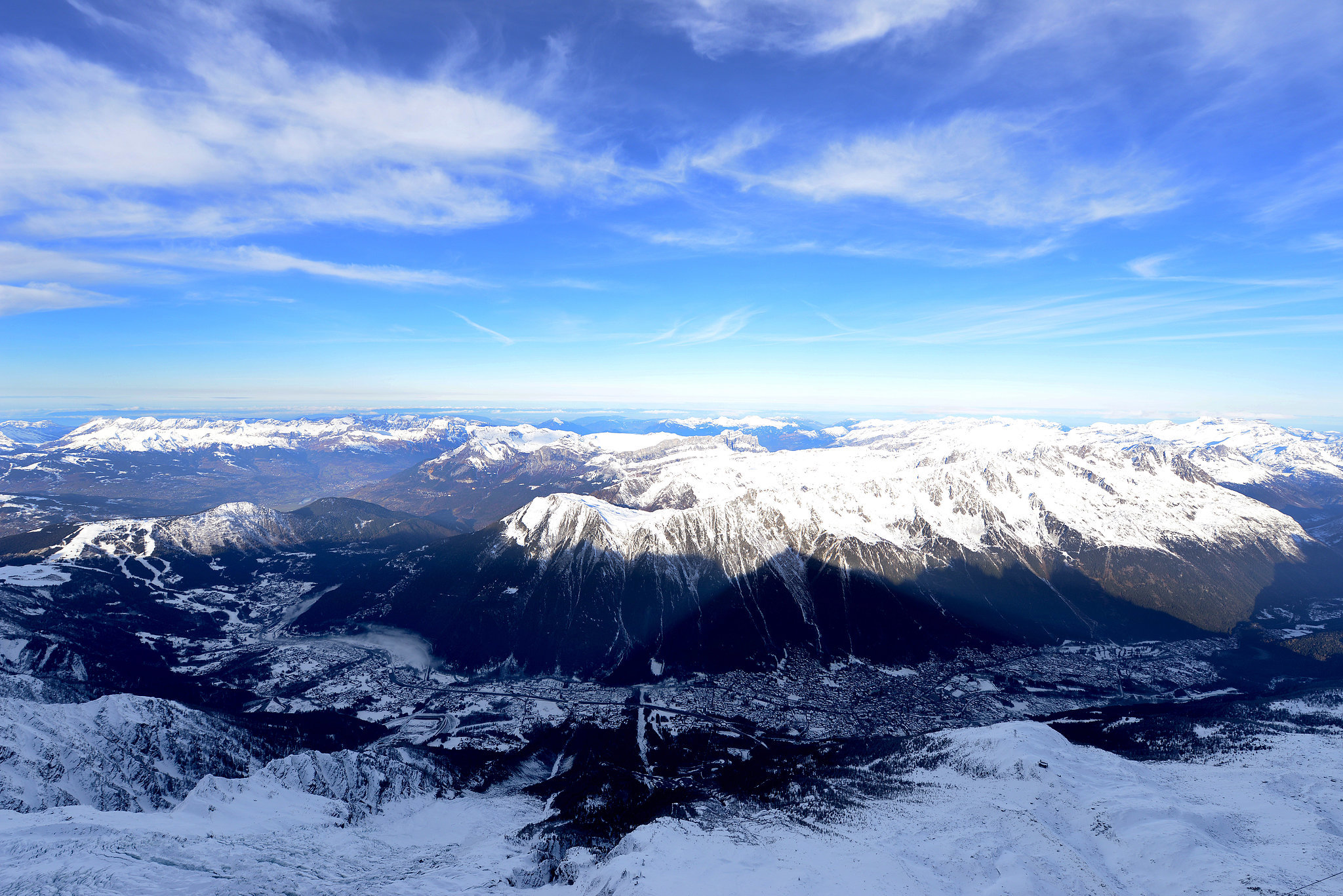 The French Alps were covered in snow on a sunny day in December.
