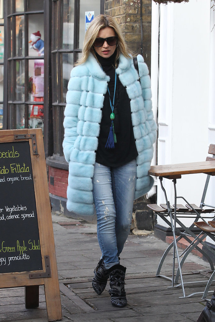 Another bold fur coat topped these ripped skinny jeans and yet another pair of ankle boots for a December shopping trip in 2012.