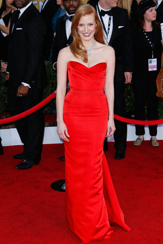 Jessica's bright red strapless gown, created by Alexander McQueen, looked great with her red hair — and even better against last year's red carpet.