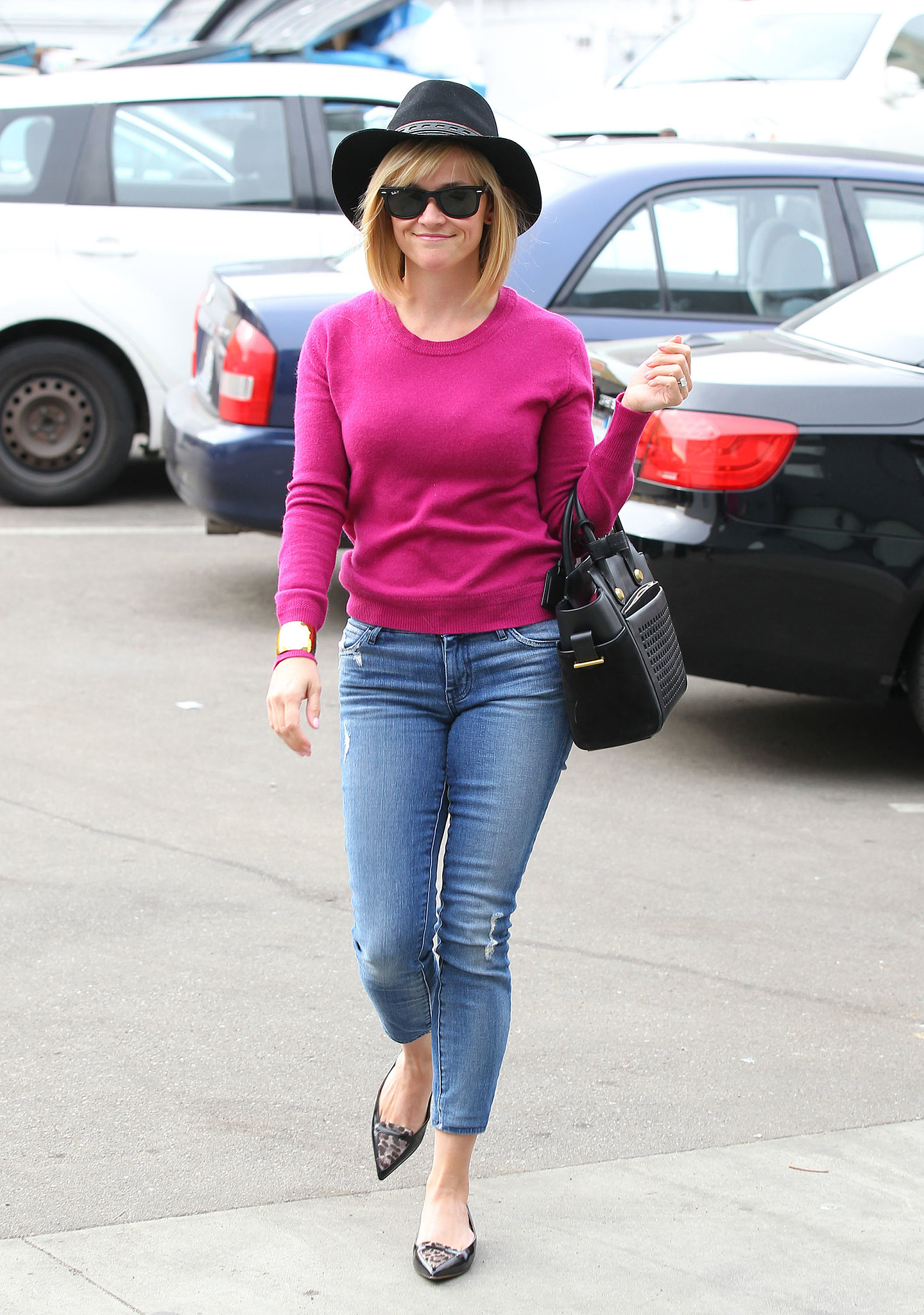 Reese Witherspoon played up the color of the year, vibrant orchid, with cropped Koral ankle jeans, pointed flats, and a perforated Reed Krakoff tote earlier this year. Where to Wear: Cheering on your favorite pro sports team.