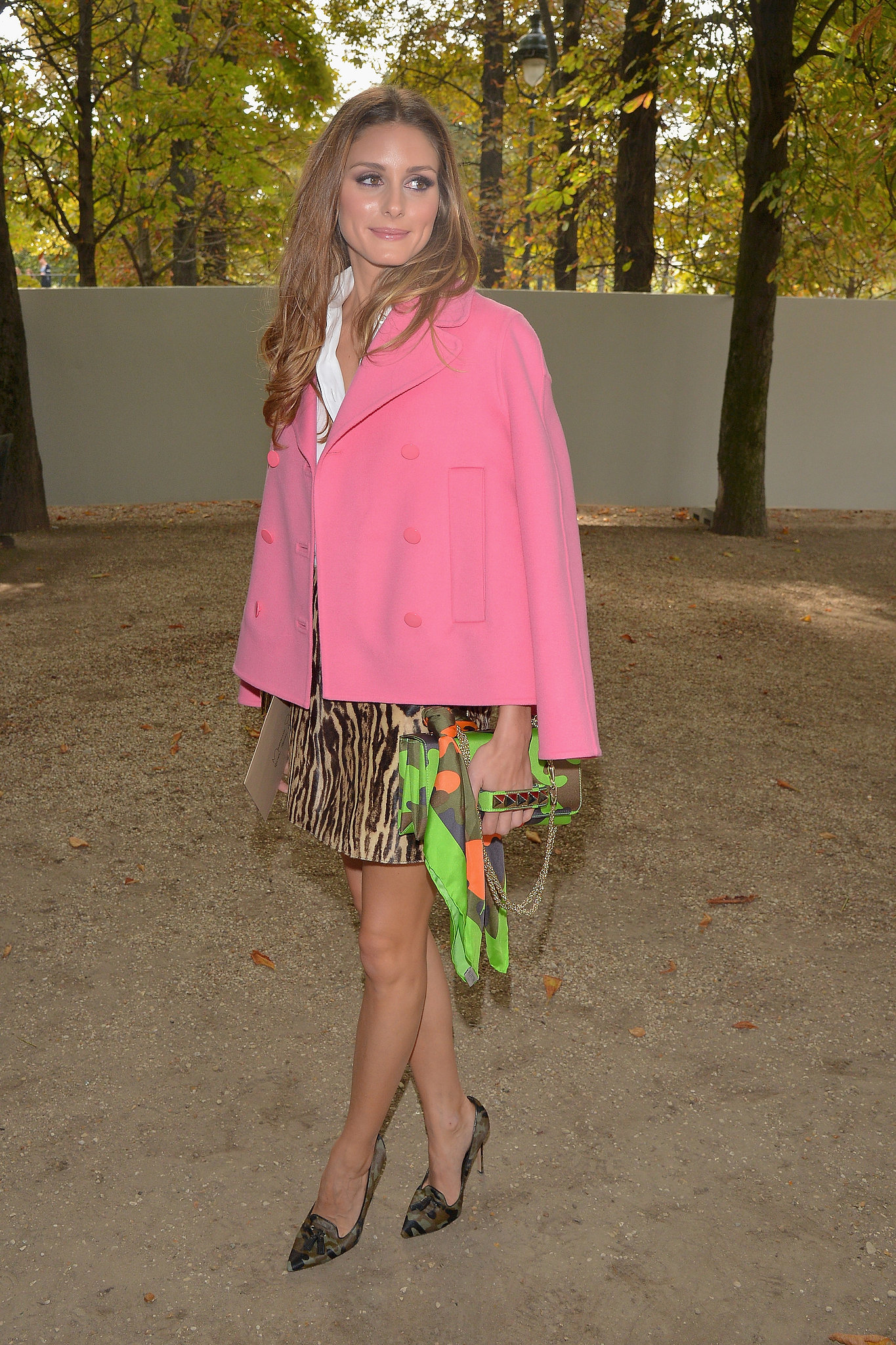 Olivia Palermo tempered a leopard-print miniskirt with a bright pink peacoat while taking in the shows during Paris Fashion Week Spring/Summer 2014. In true Olivia fashion, the star finished her look with camouflage pumps and a matching Valentino bag.  Where to Wear: Champagne brunch with Mom. Valentine's Day is about celebrating all loved on