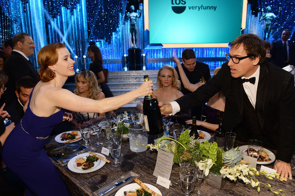 Amy Adams handed off some Champagne to David O. Russell during the SAG Awards.