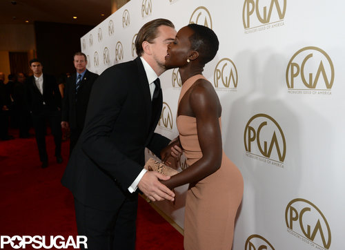 Leonardo DiCaprio kissed Lupita Nyong'o on the red carpet at the Producers Guild Awards.