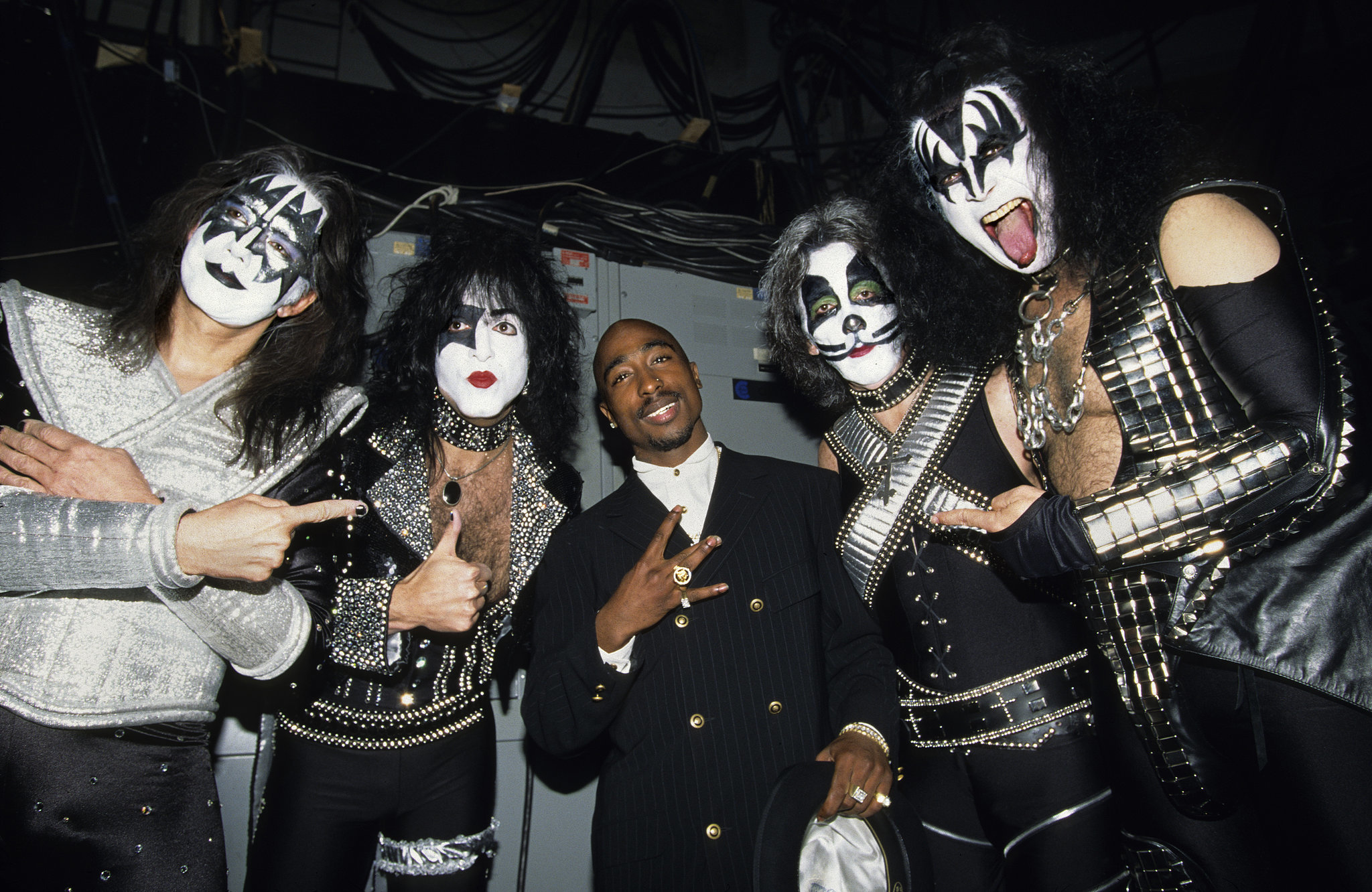 Tupac Shakur joined the members of Kiss backstage in 1996 — how hilarious is this photo?