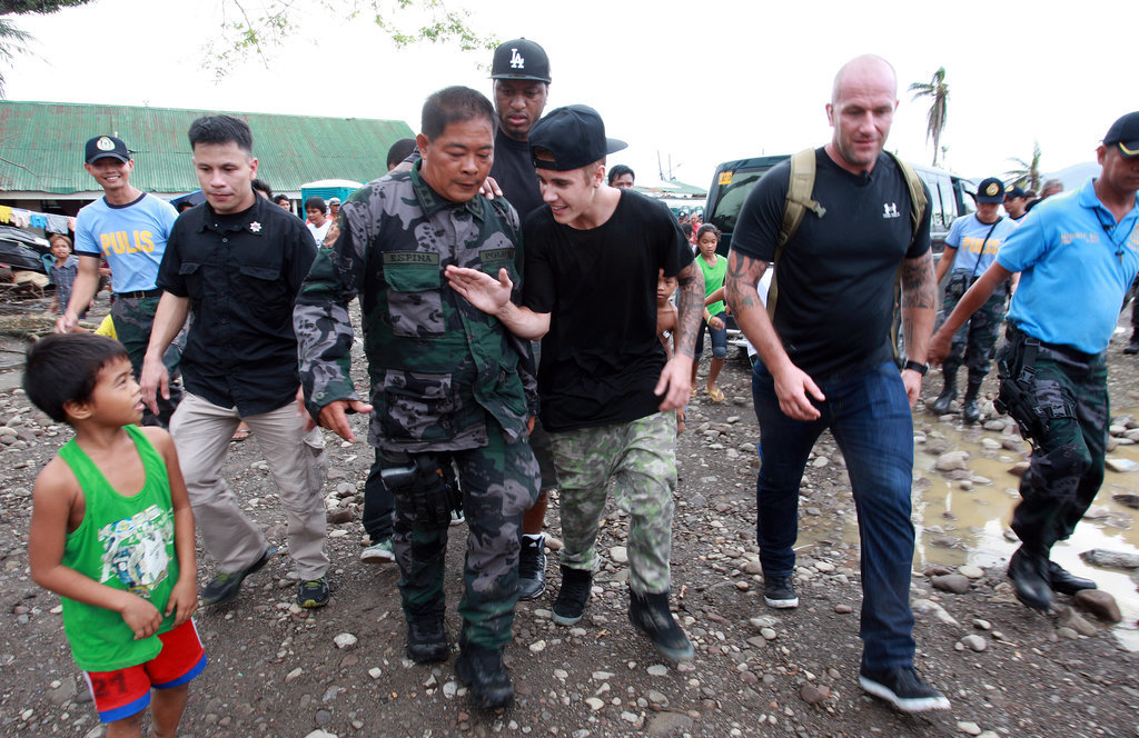 """Source: Getty/Jeoffrey Maitem  Dec. 10, 2013 The pop star got some much-needed good press when he visited an area of the Philippines that was left devastated by the recent typhoon. He spent the day meeting with children and playing basketball with a group of teenagers.  Dec. 24, 2013 Justin sent his fans into chaos when he announced via Twitter that he was """"officially retiring."""" However, he quickly backtracked and claimed it was just a joke. A source close to the singer claimed that he did it to show """"how quickly news spreads without anyone vetting if it's true or not."""" Dec. 25, 2013 On Christmas Day, Justin released Believe, the movie followup to his wildly successful first documentary, Never Say Never. However, the film was considered a bomb for the pop star, only earning $3.1 million in its opening week. For the sake of comparison, Never Say Never earned $29.5 million its opening weekend. Jan. 10, 2014 Justin allegedly egged a neighbor's home inside his ritzy Calabasas neighborhood. The neighbor released a video of the incident, which contains the voice of a young man who sounds like Justin cursing out his neighbor while throwing eggs. The neighbor called the cops on Justin and reported $20,000 in damage. Jan. 14, 2014 The star's Calabasas home was raided as part of a police investigation related to his alleged egging incident. Justin's friend Lil Za was arrested in Bieber's home for felony drug possession as part of the raid. He was released a few hours later but was arrested once again after he broke a phone inside the jail. Jan. 21, 2014 Justin reportedly spent $75,000 at a strip club in Miami while celebrating the birthday of Love & Hip Hop Atlanta star Lil Scrappy."""