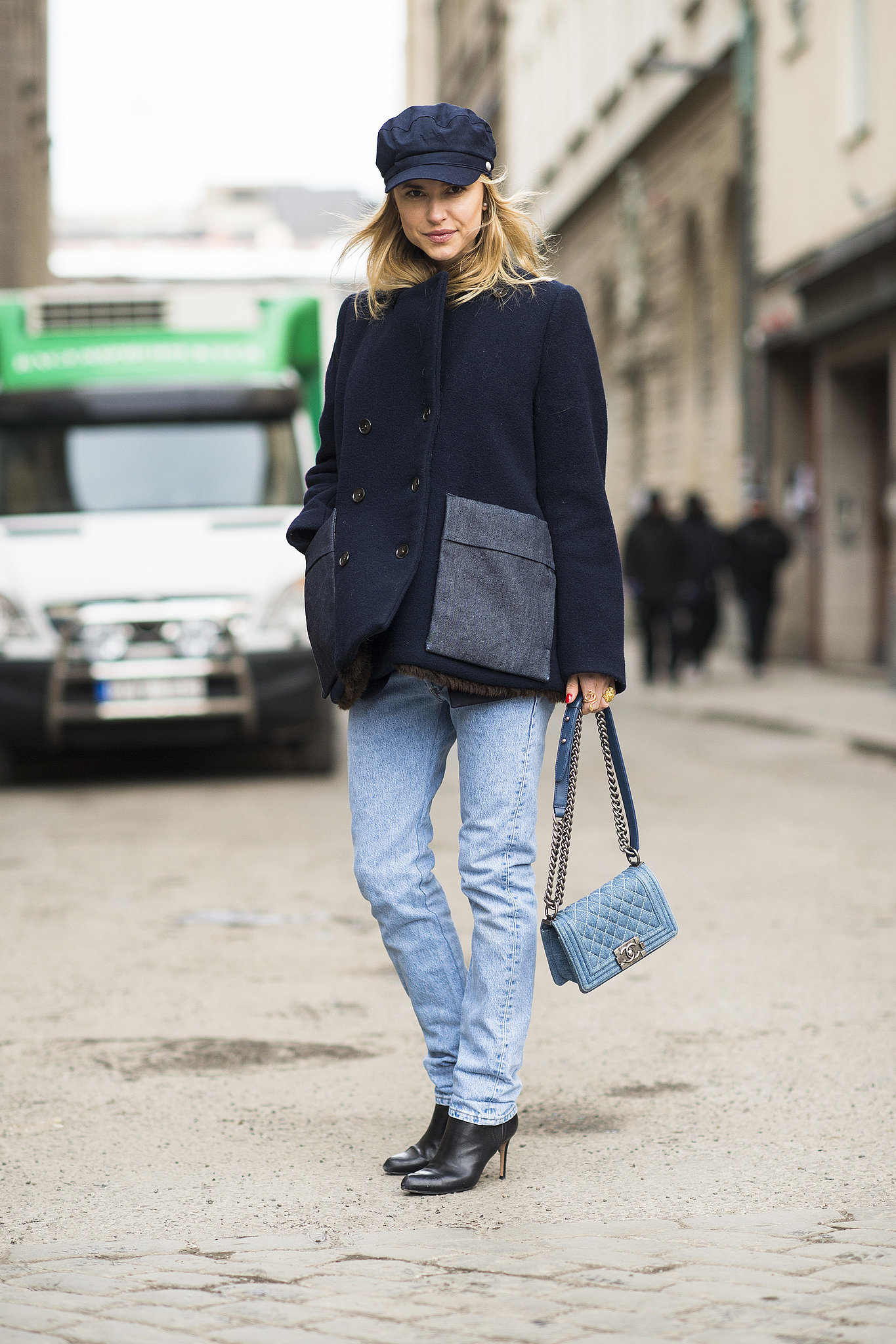 Her hat may say tomboy, but that Chanel bag says fashion darling.  Source: Le 21ème   Adam Katz Sinding