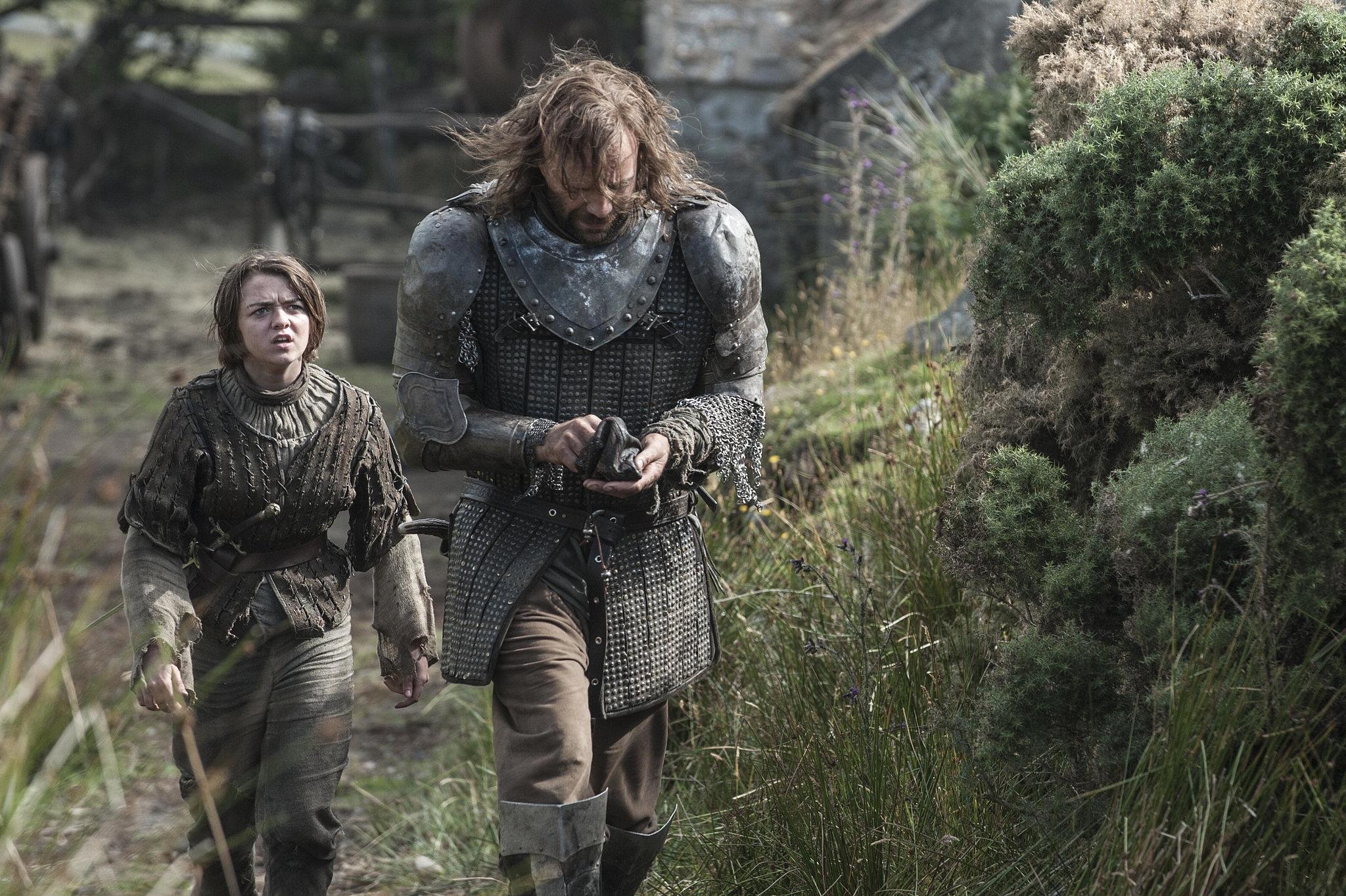 Maisie Williams as Arya Stark and Rory McCann as The Hound.