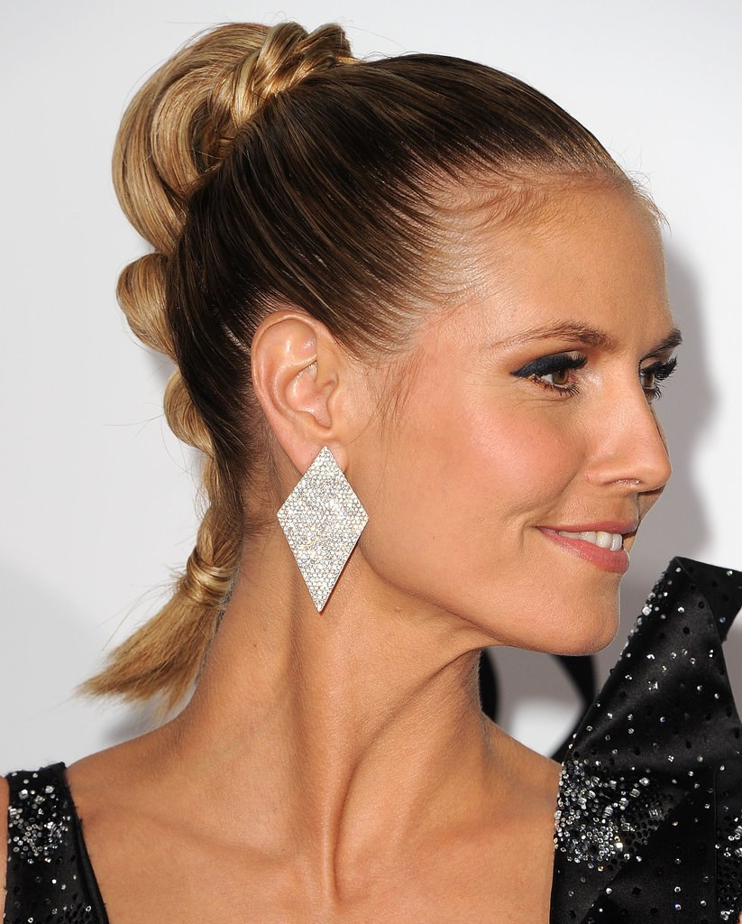 Give your ponytail a bohemian tilt by adding a twist around the elastic and down the ends à la Heidi Klum at the People's Choice Awards.