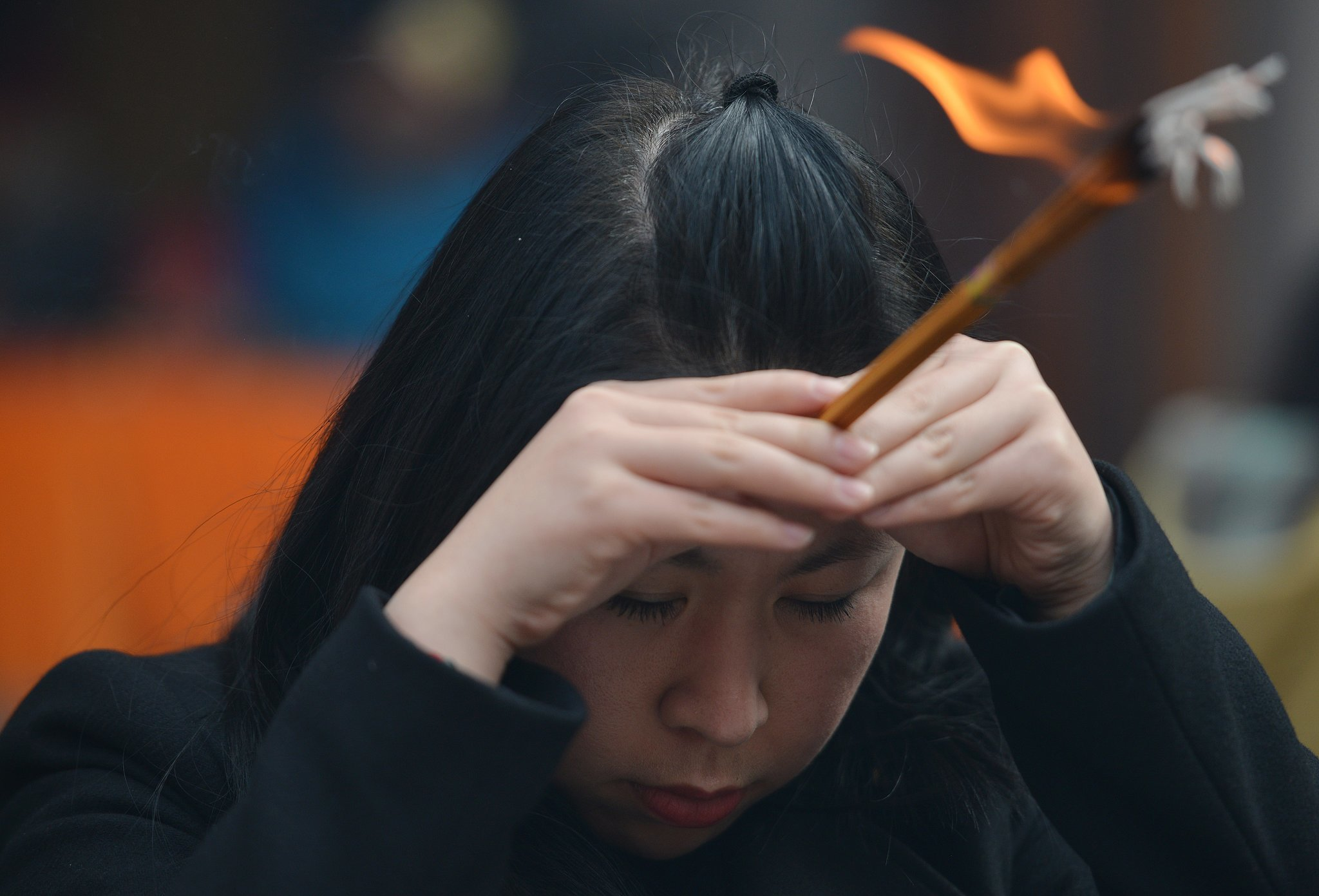 A woman carried incense as part of the prayer traditions.